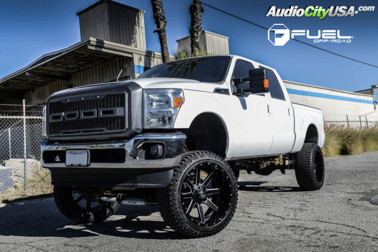 2015 Ford F-250 7.3L Diesel | 24″ Fuel Off-Road Wheels D262 Maverick Black Milled Rims | 325-45-24 Atturo Trail Blade XT Tires | 8 1/2″ Pro Comp Suspension Lift Kit
