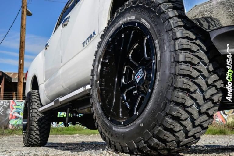 2017 Nissan Titan   20″ XD Wheels XD825 Buck25 Gloss Black Milled Rims with RBP Repulser Tires   6″ Rough Country Suspension Lift Kit   AudioCityUSA