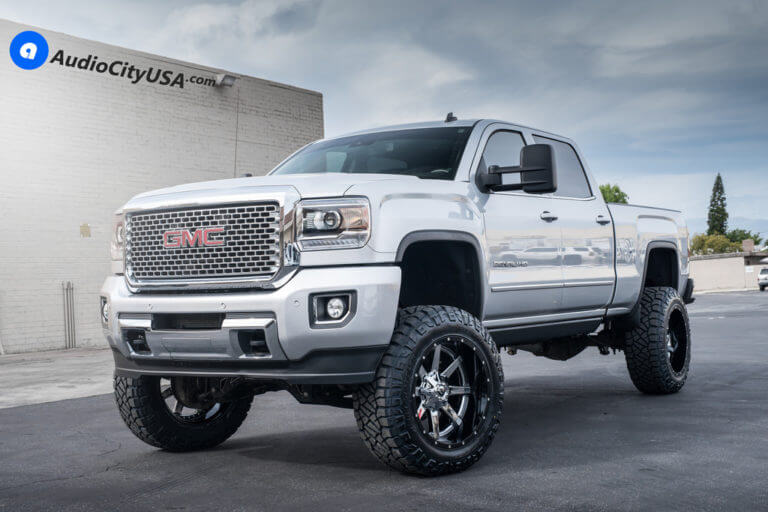 2015 GMC Denali HD 2500 | 22″ Fuel Wheels D260 Maverick Chrome with Gloss Black Lip Rims | 37×12.5×22 Nitto Ridge Grappler | 6″ McGaughy's Suspension Lift Kit | AudioCityUSA