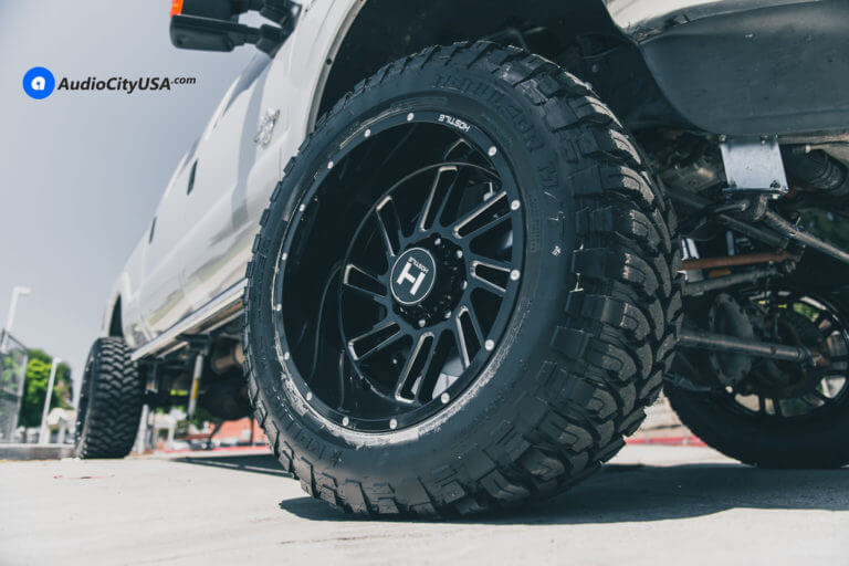 22″ Hostile Wheels Stryker Gloss Black with Milled Accents | 8″ Superlift Suspension Lift Kit | 37×13.5×22 RBP MT Tires | 2015 Ford F-250 Power Stroke 6.7