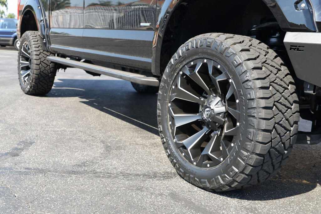 fuel wheels  assault black milled rims nitto tires ridge grappler  rough country